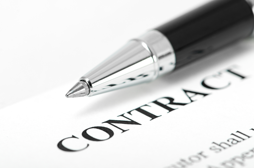 Why should a lawyer be hired to draft a contract?